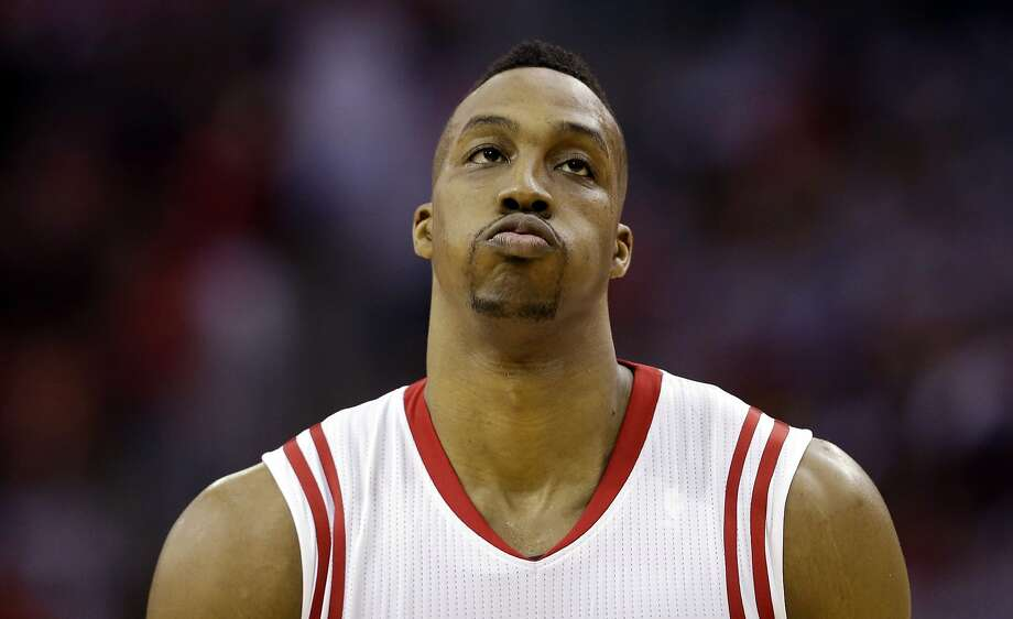 Rockets center Dwight Howard could not mask his disappointment during the second half of the Warriors' win. Photo: David J. Phillip, Associated Press