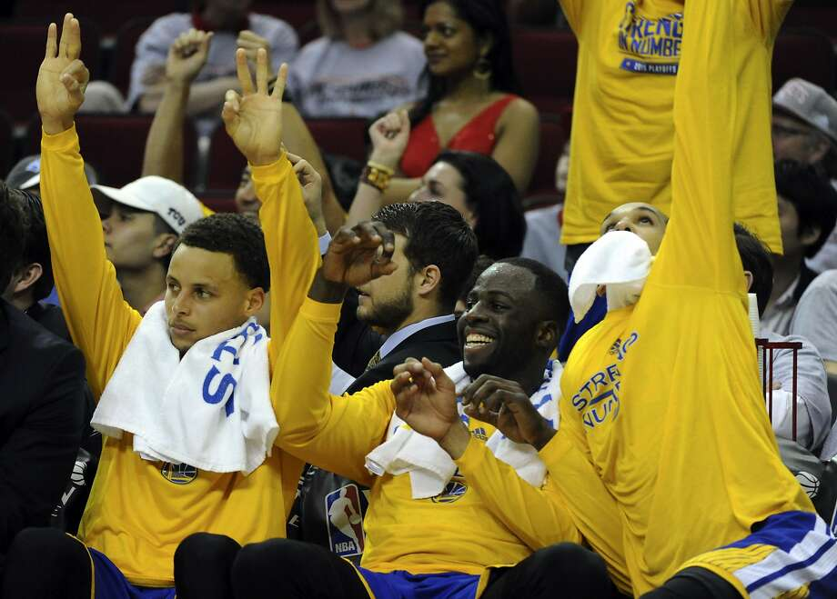 Golden State Warriors guard Stephen Curry #30 (from left),  forward Draymond Green #23 and guard Shaun Livingston #34 celebrate a Warriors' three-pointer late in the fourth quarter of Game 3 of the Western Conference Finals, Saturday, May 23, 2015, at Toyota Center in Houston, TX. Photo: Eric Christian Smith, Special To The Chronicle