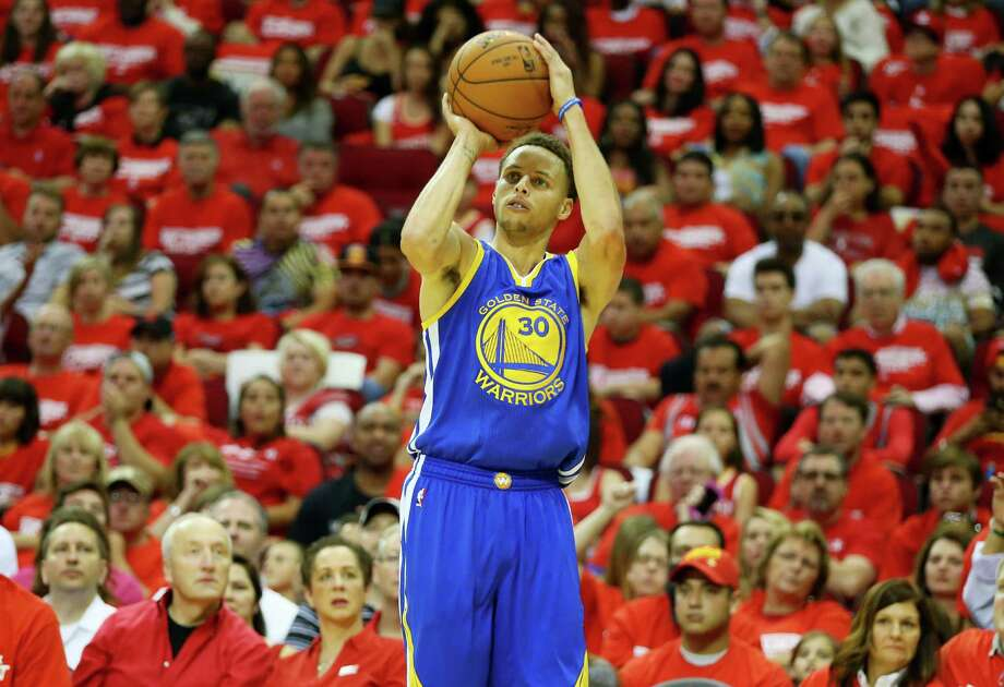 HOUSTON, TX - MAY 23:  Stephen Curry #30 of the Golden State Warriors shoots a three pointer in the third quarter against the Houston Rockets during Game Three of the Western Conference Finals of the 2015 NBA PLayoffs at Toyota Center on May 23, 2015 in Houston, Texas. NOTE TO USER: User expressly acknowledges and agrees that, by downloading and or using this photograph, user is consenting to the terms and conditions of Getty Images License Agreement.  (Photo by Ronald Martinez/Getty Images) ORG XMIT: 554941337 Photo: Ronald Martinez / 2015 Getty Images