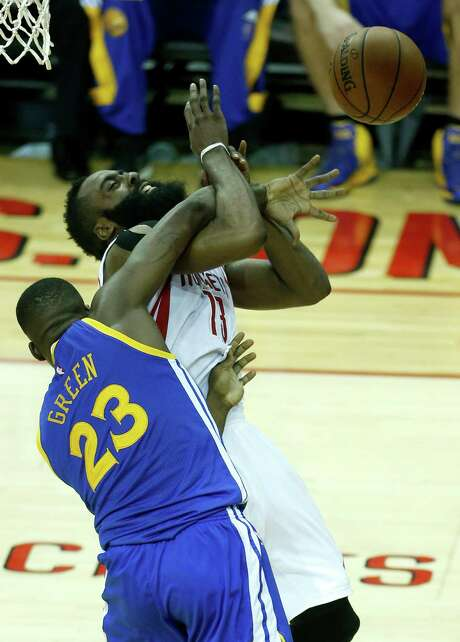 Rockets guard James Harden, top, found the going tough in Game 3 against Draymond Green and the Warriors, who won 115-80 to take a 3-0 series lead. Photo: Karen Warren, Staff / © 2015 Houston Chronicle