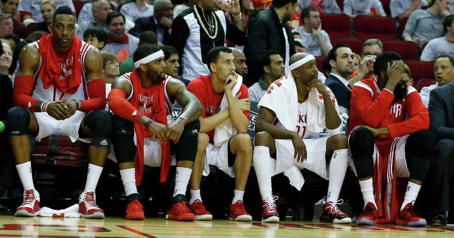 Dwight Howard, from left, Josh Smith, Pablo Prigioni, Jason Terry and James Harden can only sit and watch the devastation during the fourth quarter. Photo: James Nielsen, Staff / © 2015  Houston Chronicle