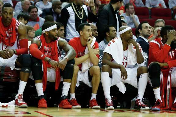 Dwight Howard, from left, Josh Smith, Pablo Prigioni, Jason Terry and James Harden can only sit and watch the devastation during the fourth quarter.