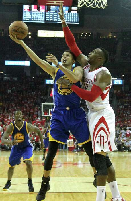 Stephen Curry, left, tries to get around Rockets center Dwight Howard, who has recovered quickly from a knee sprain suffered Tuesday.Stephen Curry, left, tries to get around Rockets center Dwight Howard, who has recovered quickly from a knee sprain suffered Tuesday. Photo: Karen Warren, Staff / © 2015 Houston Chronicle