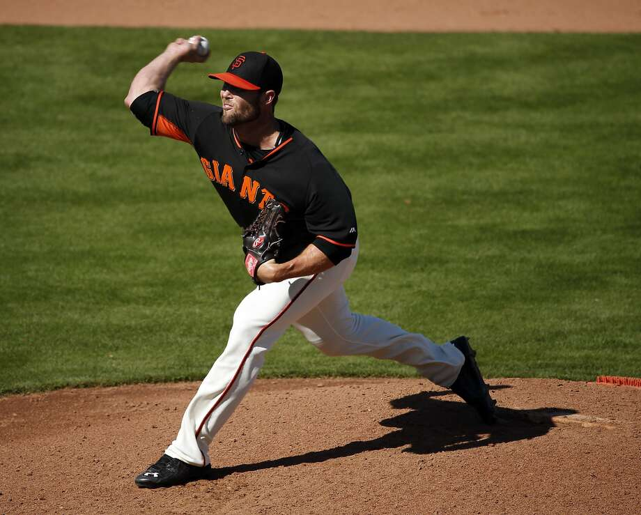 Reliever Hunter Strickland, throwing against the Padres in spring training during March, returned to the Giants roster for a day in Colorado as the 26th man for a double-header. Photo: Scott Strazzante, The Chronicle