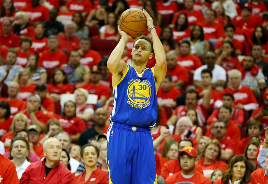 Stephen Curry shoots a three-pointer against the Rockets during Game 3 of the Western Conference Finals on May 23 in Houston. Photo: Ronald Martinez, Getty Images