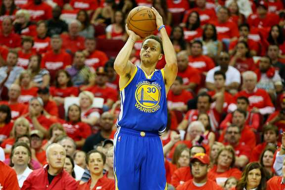 HOUSTON, TX - MAY 23:  Stephen Curry #30 of the Golden State Warriors shoots a three pointer in the third quarter against the Houston Rockets during Game Three of the Western Conference Finals of the 2015 NBA PLayoffs at Toyota Center on May 23, 2015 in Houston, Texas. NOTE TO USER: User expressly acknowledges and agrees that, by downloading and or using this photograph, user is consenting to the terms and conditions of Getty Images License Agreement.  (Photo by Ronald Martinez/Getty Images)