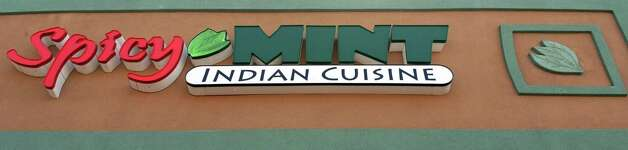 Sign above the Spicy Mint restaurant in Wolf Road Shoppers Park Thursday May 14, 2015 in Colonie, NY.  (John Carl D'Annibale / Times Union) Photo: John Carl D'Annibale, Albany Times Union / 10031844A