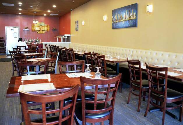 Interior of the Spicy Mint restaurant in Wolf Road Shoppers Park Thursday May 14, 2015 in Colonie, NY.  (John Carl D'Annibale / Times Union) Photo: John Carl D'Annibale, Albany Times Union / 10031844A