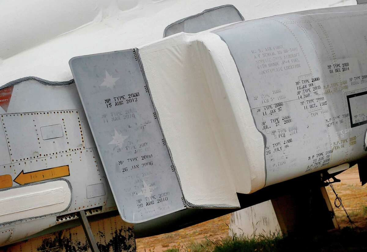 Three vertical stars, which indicate three MiG kills, are painted alongside the service records of a McDonnell Douglas F-4 Phantom II while stored at the 309th Aerospace Maintenance and Regeneration Group boneyard, Thursday, May 14, 2015 at Davis-Monthan Air Force Base in Tucson, Ariz.