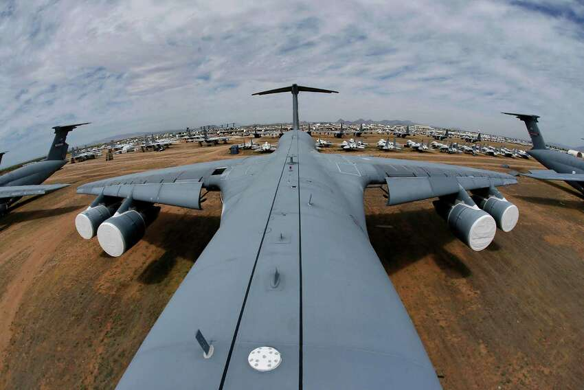 Fields of military aircraft can be seen from atop a Lockheed C-5 Galaxy cargo jet, as shown in this fisheye lens photograph, at the 309th Aerospace Maintenance and Regeneration Group boneyard Thursday, May 14, 2015 at Davis-Monthan Air Force Base in Tucson, Ariz. The C-5A Galaxy the largest aircraft in the U.S. armed services.