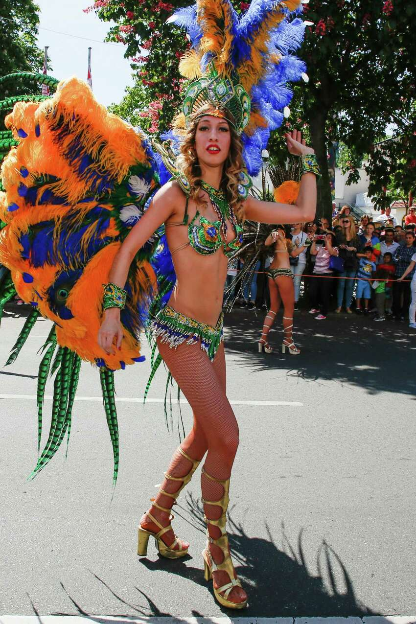 Samba dancers participate the Karneval der Kulturen parade (Carnival of Cultures) which takes place at Berlin Kreuzberg district on May 24, 2015 in Berlin, Germany. The 'Karneval der Kulturen' is a four-day urban festival that reflects Berlin's many faces with a free and open music and dance group program for professional and amateurs. (Photo by Christian Marquardt/Getty Images)