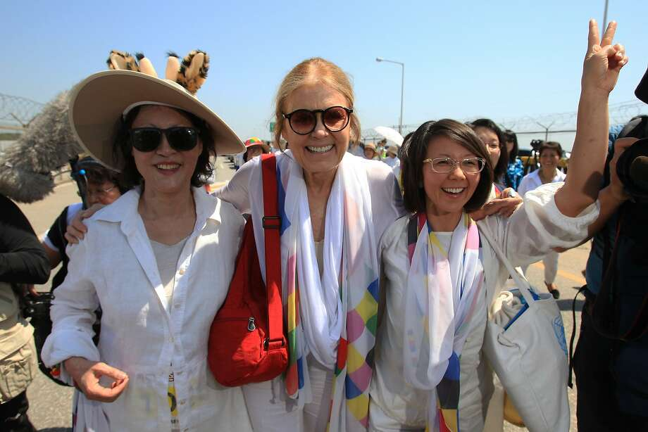 U.S. activist Gloria Steinem (C) with other activists march to the Imjingak Pavilion  along the military wire fences near the border village of Panmunjom on May 24, 2015 in Paju, South Korea. A group of female peace activists including U.S. activist Gloria Steinem and Irish Nobel Peace Prize laureate Mairead Maguire march across the Demilitarized Zone (DMZ) from the North Korea to the South Korea to deliver a peace message on the International Women's Day for Peace and Disarmament. The DMZ bisects the Korean Peninsula, a legacy of the 1950-53 Korean War. Photo: Chung Sung-Jun, Getty Images