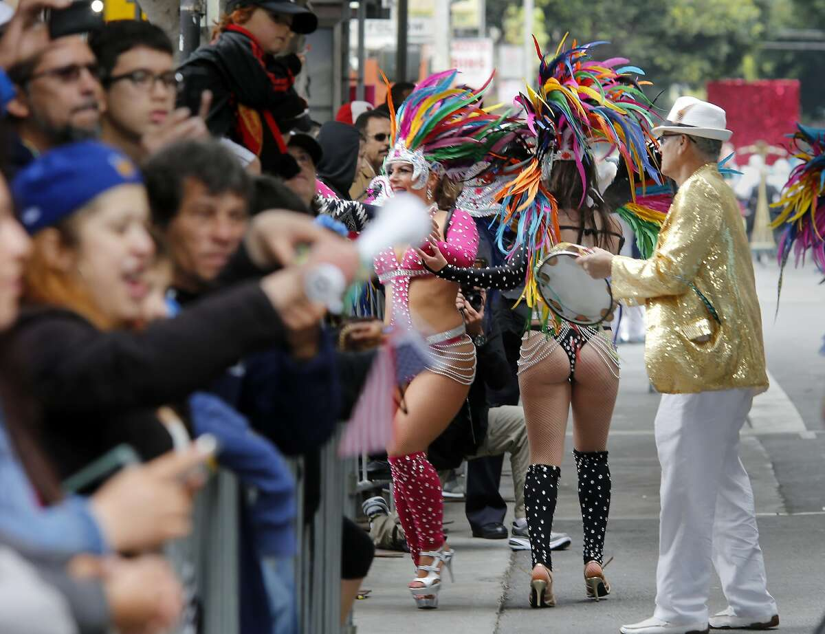 Some samba dancers greeted the crowds as they marched through the Mission Sunday May 24, 2015. The 37th annual Grand Carnaval Parade transformed the Mission District of San Francisco into a celebration of Latin music with dozens of local dance troupes, schools and samba everywhere.