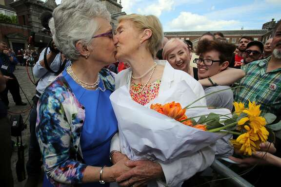 Irish Senator Katherine Zappone (L) kisses her partner Ann Louise Gilligan as supporters for same-sex marriage wait for the result of the referendum at Dublin Castle on May 23, 2015 in Dublin. Yes voters were basking in the sunshine today as they gathered to celebrate an expected victory in Ireland's referendum on whether to approve same-sex marriage. AFP PHOTO /  Paul FaithPAUL FAITH/AFP/Getty Images