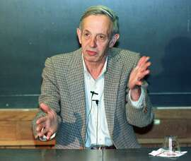 """FILE - In this Oct. 11, 1994 file photo, Princeton University professor John Nash speaks during a news conference at the school in Princeton, N.J., after being named the winner of the Nobel Peace Prize for economics. Nash, whose struggle with schizophrenia was chronicled in the 2001 movie """"A Beautiful Mind,"""" died in a car crash along with his wife in New Jersey on Saturday, May 23, 2015, police said. (AP Photo/Charles Rex Arbogast, File)"""