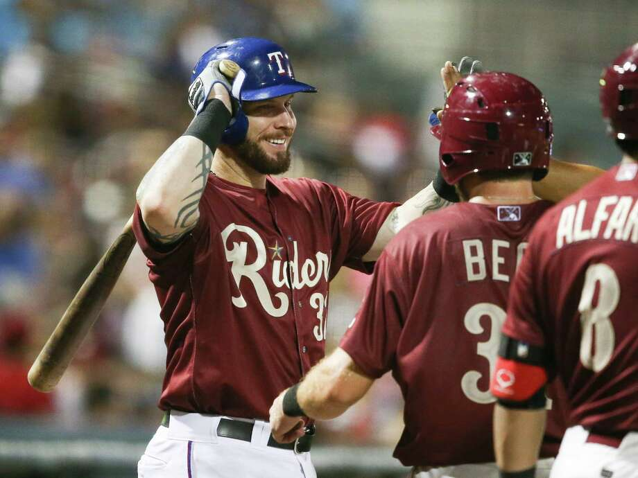 Texas Rangers' Josh Hamilton congratulates teammate Preston Beck for scoring against the Corpus Christ Hooks, during a rehab baseball game with the Frisco RoughRiders, Saturday, May 16, 2015, in Frisco, Texas. Photo: Jim Cowsert /Fort Worth Star-Telegram / Fort Worth Star-Telegram