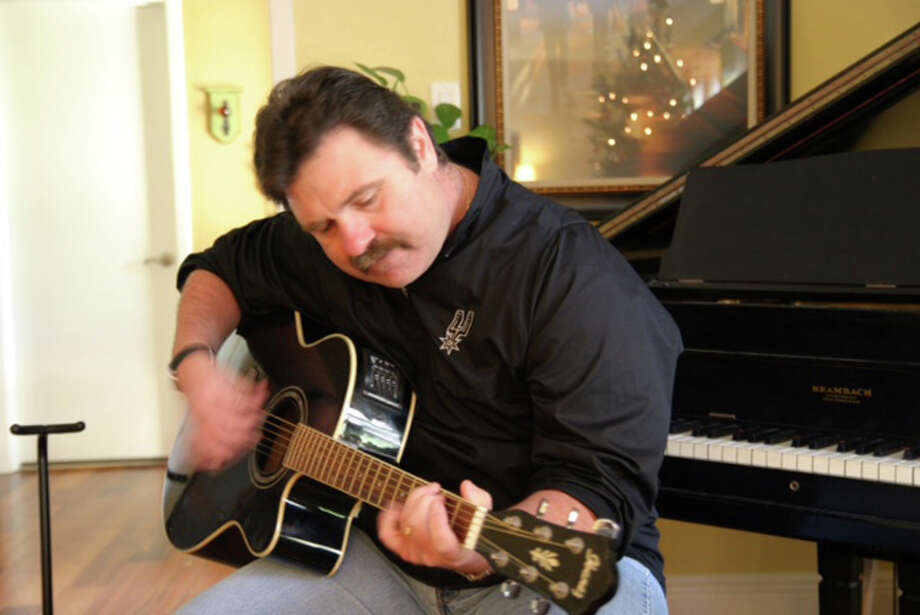 San Antonio Spurs broadcaster Bill Schoening strumming his guitar. Photo: Courtesy Photo