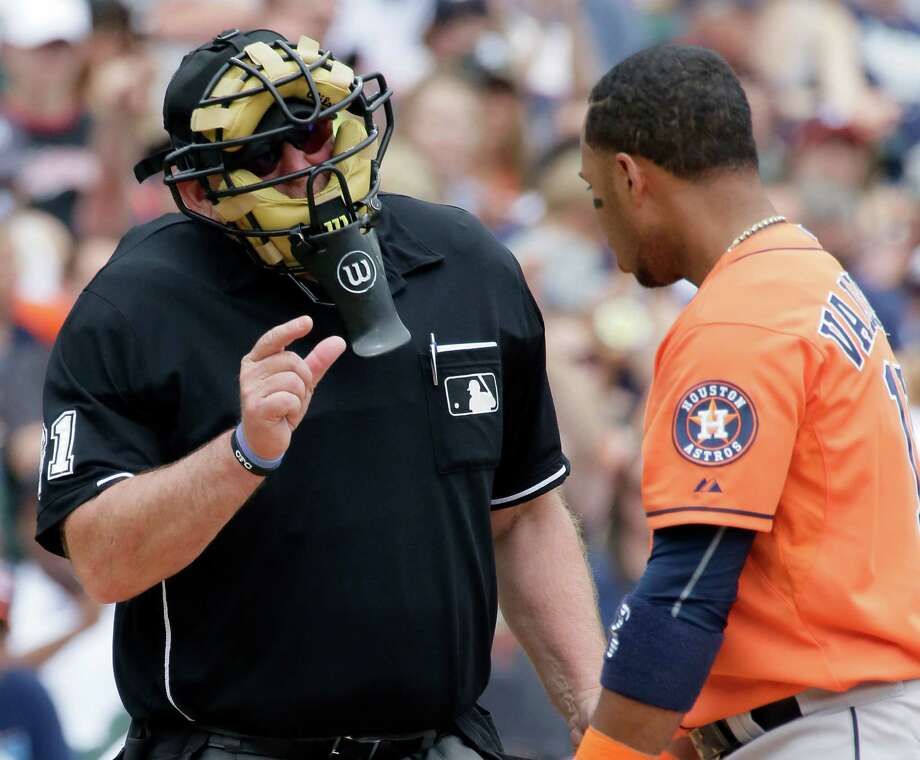 """""""You missed it by this much,"""" plate umpire Bob Davidson appears to be telling Astros third baseman Luis Valbuena, who struck out in the fifth inning of Sunday's game at Detroit. Valbuena went 0-for-5 with two strikeouts. Photo: Duane Burleson, FRE / FR38952 AP"""