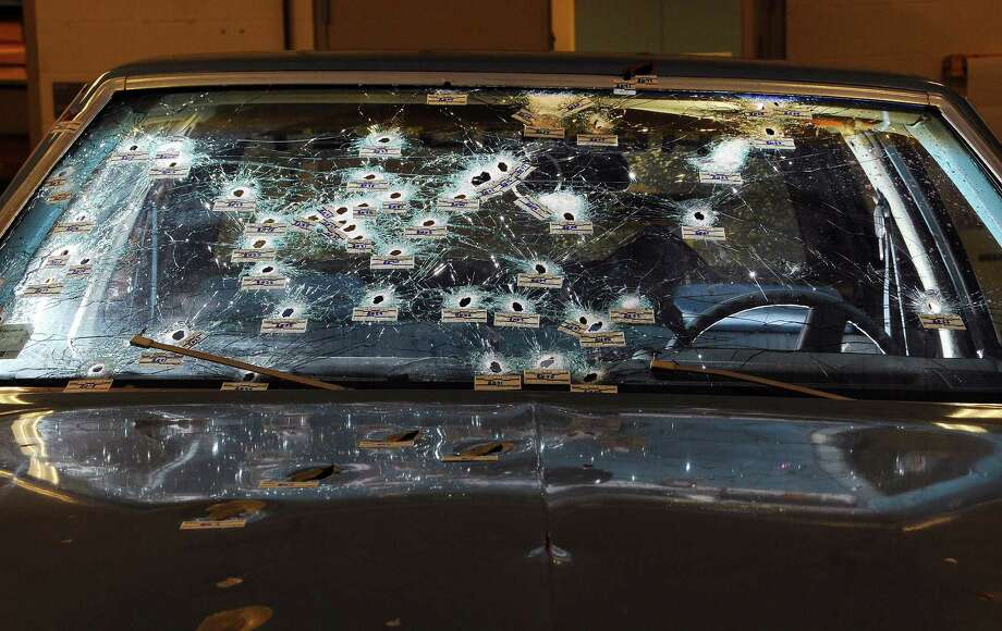 In a photo provided by the Office of the Ohio Attorney General, bullet holes are visible on the windshield and hood of a vehicle involved in a 22-mile police pursuit. Police arrested 71 protesters overnight after demonstrations over the acquittal of an officer who climbed onto the hood of the car after the chase and repeatedly shot at the two unarmed black occupants, the Cleveland police chief said Sunday, May 24, 2015. (Office of the Ohio Attorney General via The New York Times) -- EDITORIAL USE ONLY Photo: OFFICE OF THE OHIO ATTORNEY GENE, HO / New York Times / OFFICE OF THE OHIO ATTORNEY GENE