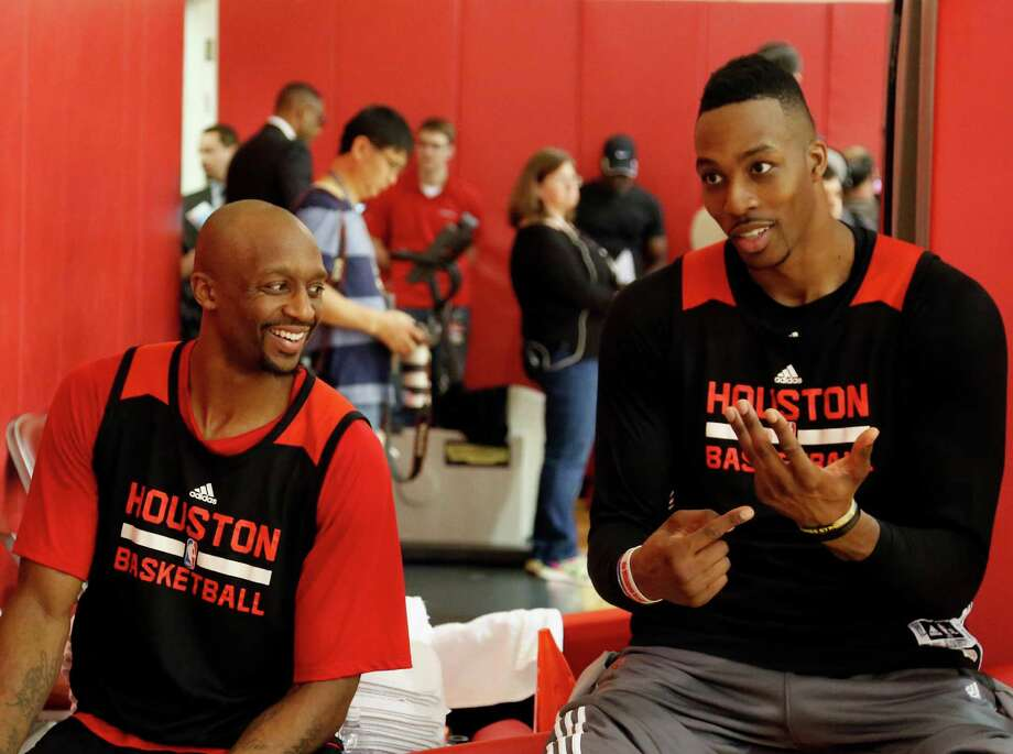 """Rockets guard Jason Terry, left, and center Dwight Howard enjoy a lighter moment during Sunday's practice at Toyota Center. Howard said the team has """"got to find a way to stay positive"""" after being routed in Game 3. Photo: James Nielsen, Staff / © 2015  Houston Chronicle"""