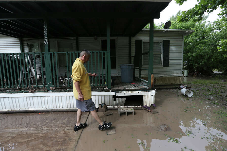 Rafael Zuniga checks out his mobile home after flooding occured overnight in San Marcos, Sunday, May 24, 2015. Heavy rains fell throughout Saturday overflowing the Blanco River and flooding residents in the San Marcos Mobile Home Park. Photo: JERRY LARA, Staff / San Antonio Express-News / © 2015 San Antonio Express-News