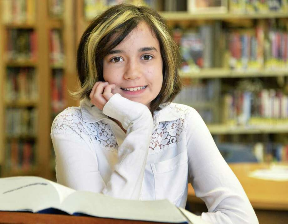 National spelling bee competitor Lydia Loverin, 13, in the library at New Lebanon Junior-Senior High School Friday April 24, 2015 in Ne w Lebanon, NY.  (John Carl D'Annibale / Times Union) Photo: John Carl D'Annibale / 00031575A