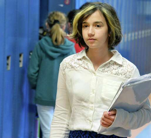 National spelling bee competitor Lydia Loverin, 13, makes her way to class at New Lebanon Junior-Senior High School Friday April 24, 2015 in Ne w Lebanon, NY.  (John Carl D'Annibale / Times Union) Photo: John Carl D'Annibale / 00031575A