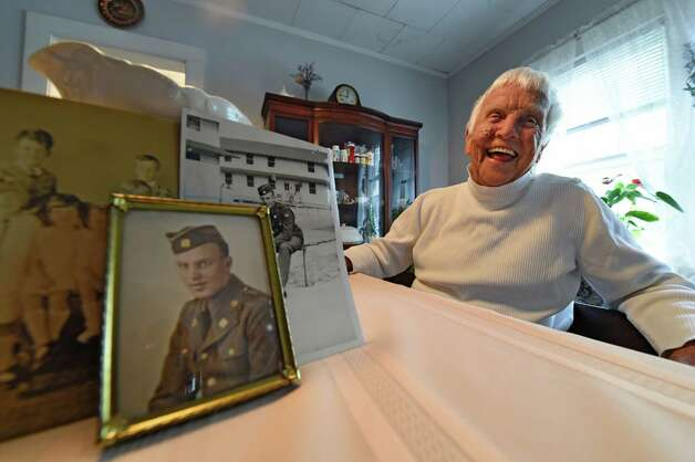 Photos of Dorothy Scoons' brother, Sgt. William C. Adams who was killed in WW II sits on the kitchen table morning May 20, 2015 in Delmar, N.Y.      (Skip Dickstein/Times Union) Photo: SKIP DICKSTEIN / 00031918A