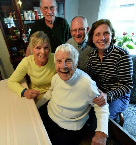 Dorothy Scoons and family gather around the kitchen table morning May 20, 2015 in Delmar, N.Y.  From left to right;  Kathryn Harter, left behind Scoons, Rich Adams, second from right behind Schoons, Diane Dunston, right and Syd Dunston, Center rear.    (Skip Dickstein/Times Union) Photo: SKIP DICKSTEIN / 00031918A