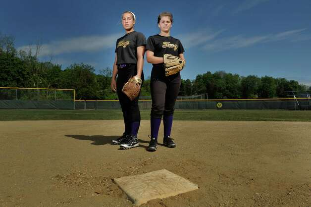 Troy High School softball players, Alina Germinerio, left, and Kaitlin Delsignore, pose for a photo near second base on Thursday, May 21, 2015, in Troy, N.Y.   (Paul Buckowski / Times Union) Photo: PAUL BUCKOWSKI / 00031938A