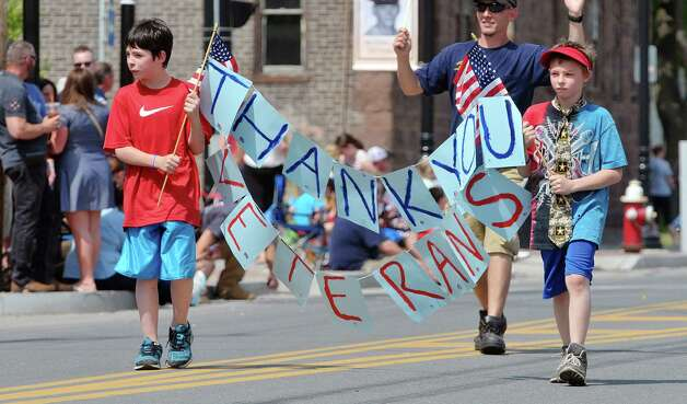 Ethan Badi, left, 8, and Gabriel Petersen, 8, carry a sign that says thank you veterans as they march with the Rensselaer Post 4446 Fraternal Order of Eagles in the  Rensselaer Memorial Day Parade on Sunday, May 24, 2015, in Rensselaer, N.Y.   (Paul Buckowski / Times Union) Photo: PAUL BUCKOWSKI / 00031978A