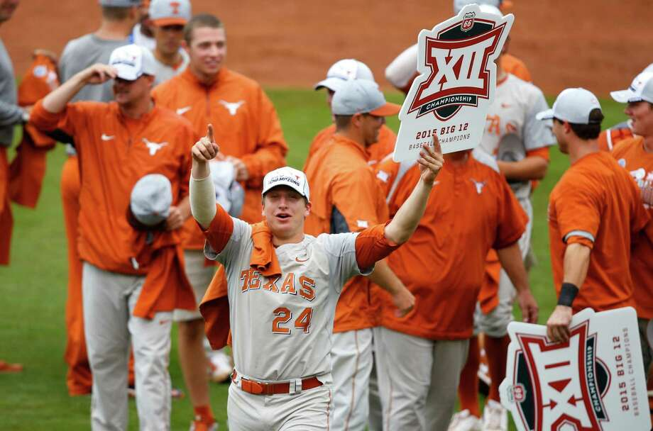 With a sign declaring the Texas Longhorns 2015 Big 12 tournament champions, UT's Parker French salutes the team's fans after Sunday's title game at Tulsa, Okla. Photo: Sue Ogrocki, STF / AP