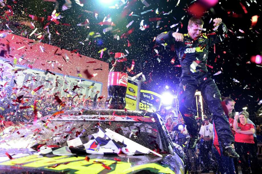 CHARLOTTE, NC - MAY 24: Carl Edwards, driver of the #19 Subway Toyota, celebrates in Victory Lane after winning the NASCAR Sprint Cup Series Coca-Cola 600 at Charlotte Motor Speedway on May 24, 2015 in Charlotte, North Carolina.  (Photo by Jared C. Tilton/Getty Images) ORG XMIT: 555328731 Photo: Jared C. Tilton / 2015 Getty Images