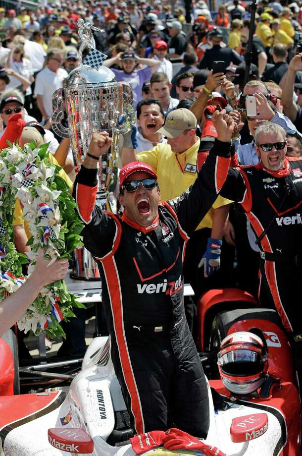 Juan Pablo Montoya, of Colombia, celebrates after winning the 99th running of the Indianapolis 500 auto race at Indianapolis Motor Speedway in Indianapolis, Sunday, May 24, 2015. (AP Photo/Darron Cummings) ORG XMIT: NAA133 Photo: Darron Cummings / AP