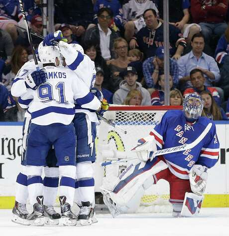 Rangers goalie Henrik Lundqvist, right, looks at the scoreboard in vain as the Lightning celebrate a second-period goal during Game 5 in New York. Photo: Frank Franklin, STF / AP