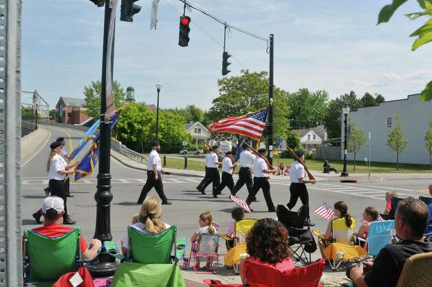 Color guard marches along Broadway as they lead the Rensselaer Memorial Day Parade on Sunday, May 24, 2015, in Rensselaer, N.Y.   (Paul Buckowski / Times Union) Photo: PAUL BUCKOWSKI / 00031978A