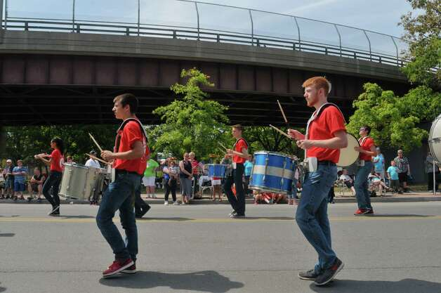 Members of the Rensselaer High School marching band perform along Broadway as they take part in the Rensselaer Memorial Day Parade on Sunday, May 24, 2015, in Rensselaer, N.Y.   (Paul Buckowski / Times Union) Photo: PAUL BUCKOWSKI / 00031978A