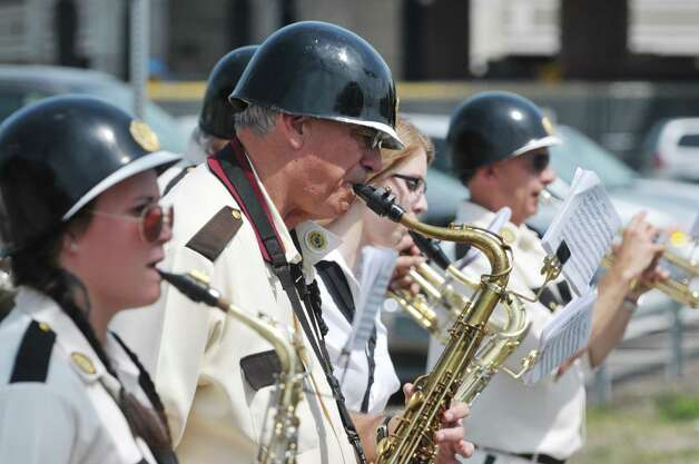 Members of the Fort Crailo Post Yankee Doodle Band perform as they march in the Rensselaer Memorial Day Parade on Sunday, May 24, 2015, in Rensselaer, N.Y.   (Paul Buckowski / Times Union) Photo: PAUL BUCKOWSKI / 00031978A