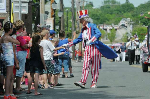 Fred Polnisch, dressed as Uncle Sam, shakes hands along the parade route at the Rensselaer Memorial Day Parade on Sunday, May 24, 2015, in Rensselaer, N.Y.   (Paul Buckowski / Times Union) Photo: PAUL BUCKOWSKI / 00031978A