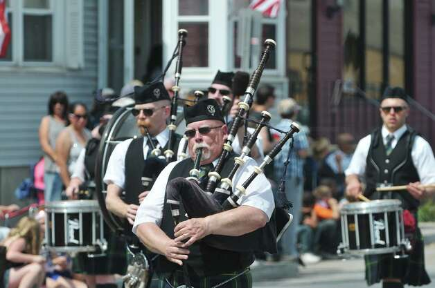 Members of the Schenectady Pipe Band perform as they march in the Rensselaer Memorial Day Parade on Sunday, May 24, 2015, in Rensselaer, N.Y.   (Paul Buckowski / Times Union) Photo: PAUL BUCKOWSKI / 00031978A