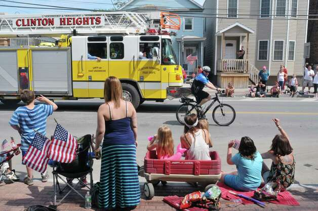 People along the parade route wave at participants in the Rensselaer Memorial Day Parade on Sunday, May 24, 2015, in Rensselaer, N.Y.   (Paul Buckowski / Times Union) Photo: PAUL BUCKOWSKI / 00031978A