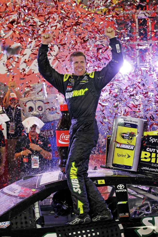 There was a lot for Carl Edwards to celebrate Sunday after winning the Coca-Cola 600 for his first victory since joining Joe Gibbs Racing this past offseason. Photo: Terry Renna, FRE / FR60642 AP