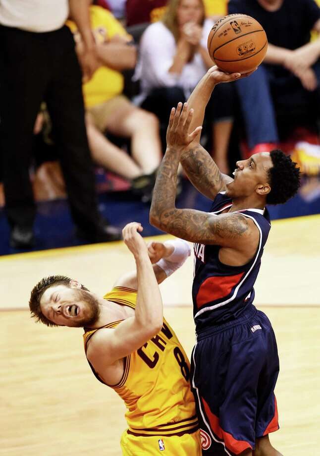 CLEVELAND, OH - MAY 24:  Jeff Teague #0 of the Atlanta Hawks shoots against Matthew Dellavedova #8 of the Cleveland Cavaliers in the fourth quarter during Game Three of the Eastern Conference Finals of the 2015 NBA Playoffs at Quicken Loans Arena on May 24, 2015 in Cleveland, Ohio. NOTE TO USER: User expressly acknowledges and agrees that, by downloading and or using this Photograph, user is consenting to the terms and conditions of the Getty Images License Agreement.  (Photo by Jason Miller/Getty Images) Photo: Jason Miller, Stringer / 2015 Getty Images