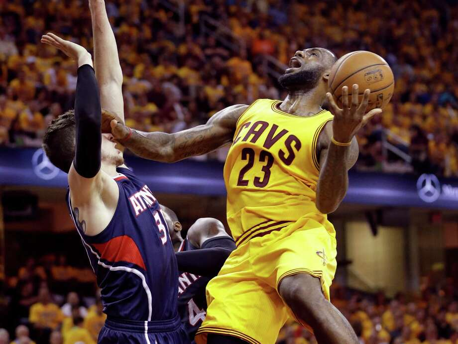 Cleveland Cavaliers' LeBron James (23) goes up for a shot against Atlanta Hawks' Mike Muscala during the second half in Game 3 of the Eastern Conference finals of the NBA basketball playoffs Sunday, May 24, 2015, in Cleveland. (AP Photo/Tony Dejak) ORG XMIT: OHMD130 Photo: Tony Dejak / AP