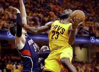 Cleveland Cavaliers' LeBron James (23) goes up for a shot against Atlanta Hawks' Mike Muscala during the second half in Game 3 of the Eastern Conference finals of the NBA basketball playoffs Sunday, May 24, 2015, in Cleveland. (AP Photo/Tony Dejak) ORG XMIT: OHMD130