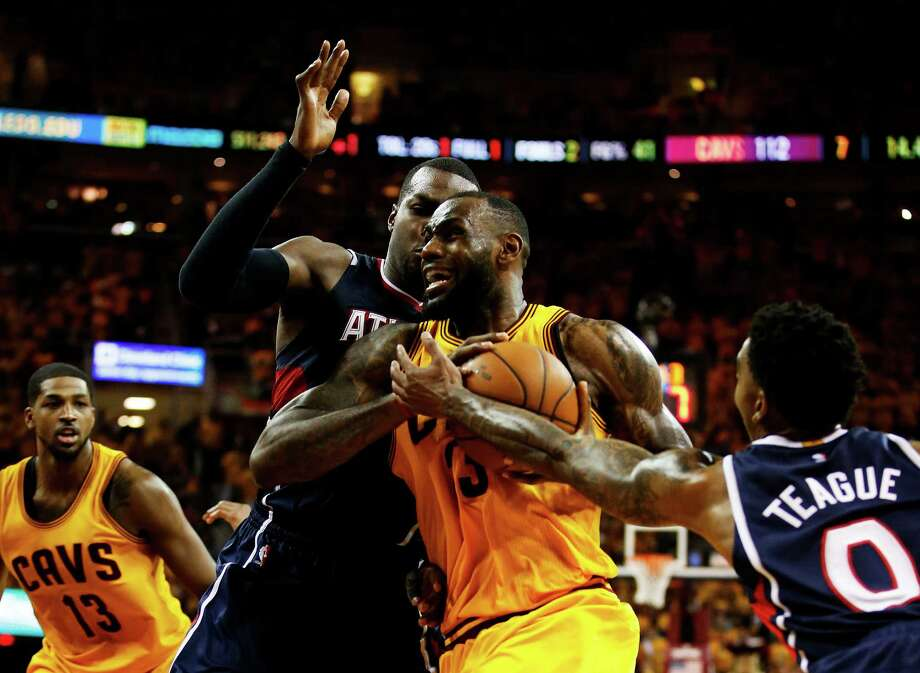 CLEVELAND, OH - MAY 24:  LeBron James #23 of the Cleveland Cavaliers drives against the Atlanta Hawks in overtime during Game Three of the Eastern Conference Finals of the 2015 NBA Playoffs at Quicken Loans Arena on May 24, 2015 in Cleveland, Ohio. NOTE TO USER: User expressly acknowledges and agrees that, by downloading and or using this Photograph, user is consenting to the terms and conditions of the Getty Images License Agreement.  (Photo by Gregory Shamus/Getty Images) Photo: Gregory Shamus, Stringer / Getty Images / 2015 Getty Images