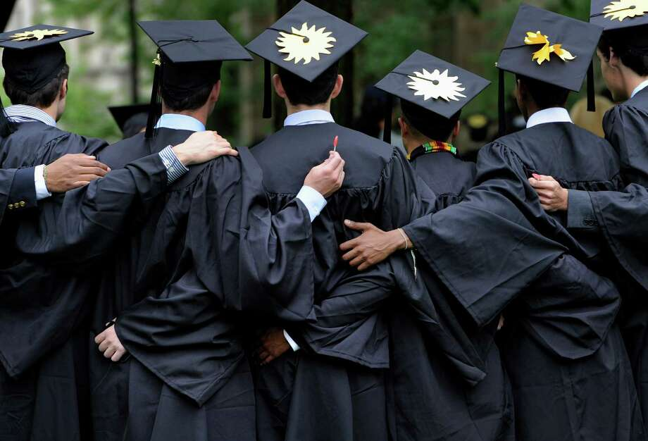 According to a survey by the Collegiate Employment Research Institute at Michigan State University, hiring of new grads is expected to jump 15 percent for the 2015-16 academic year. Photo: Associated Press File Photo / FR125654 AP