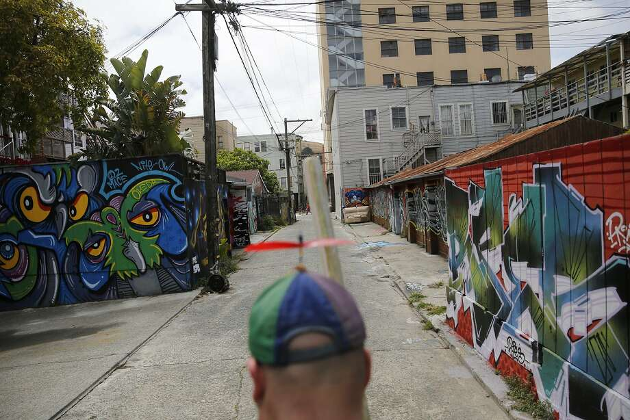 On his day off, chalk artist Nikolas Larson heads out to make a new geometric design. Photo: Mike Kepka, The Chronicle