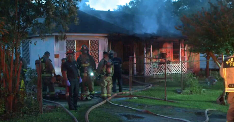 Houston firefighters work to control a blaze early Monday morning at a home in the 6800 block of Bacher in northeast Houston.