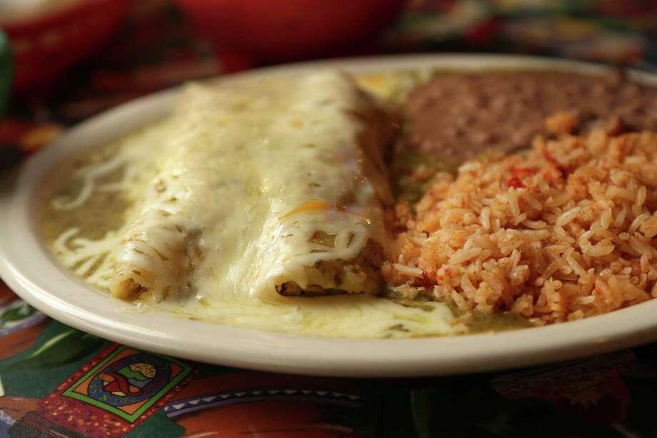 Green chicken enchiladas at Lupita's Mexican Restaurant Photo: Karen Warren, Staff / © 2013 Houston Chronicle